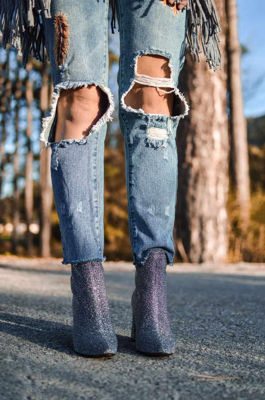 women's knees in ripped jeans